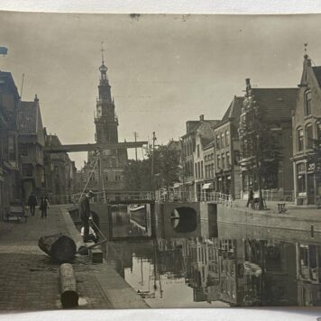 [2 antique photo's, 2 foto's, Alkmaar] Two original photo's with street and canal in Alkmaar. Old car driving, and fishing man in front of the church and suspension bridge (hangbrug). ed around 1800. (kopie)